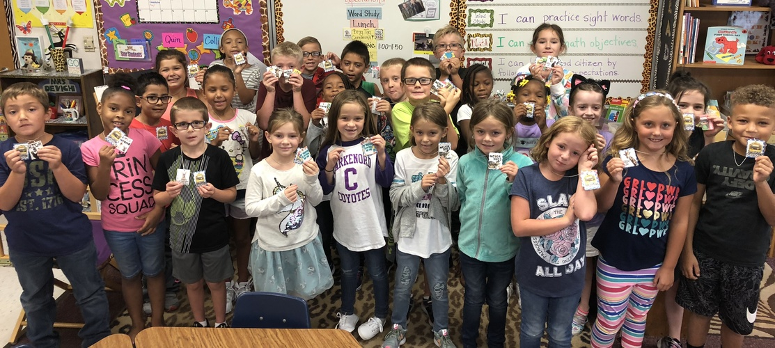 students posing with brag tags