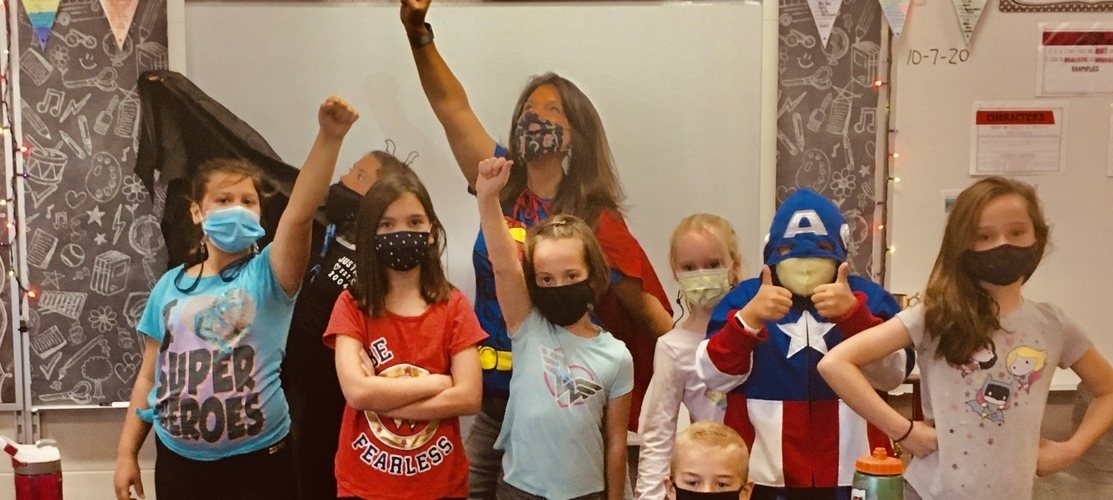 class dressed as super heroes