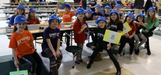 Atwood students wearing hard hats and smiling.